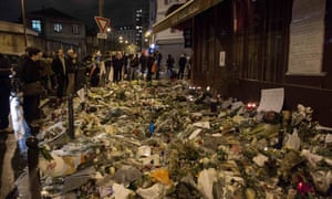 Flowers, candles and messages left outside Le Carillon restaurant in the 11th arrondissement of Paris, one of the venues targeted by gunmen last Friday.