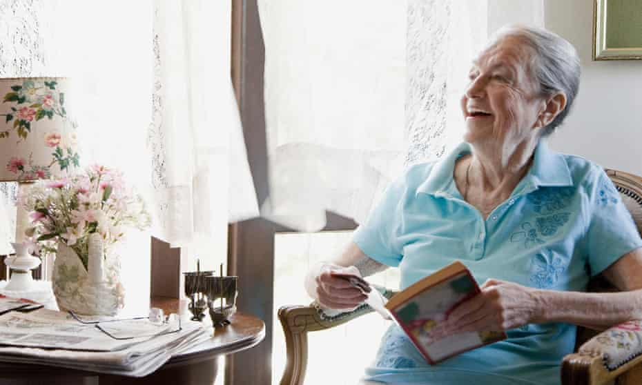Mature woman smiling with book