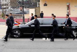 Security guards surround Kim's limousine
