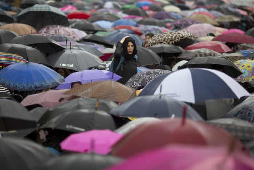 Hundreds of protesters carrying umbrellas take part in a demonstration demanding an end to violence against women in Buenos Aires.