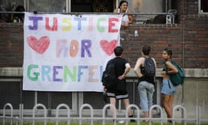 Justice for Grenfell banner in area near the Tower