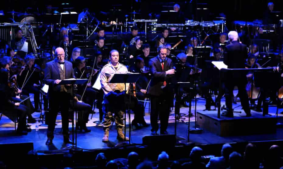 John Adams conducts the BBC Symphony Orchestra in his 2005 opera Doctor Atomic at the Barbican, with (l-r) Brindley Sherratt, Aubrey Allicock and Gerald Finley.