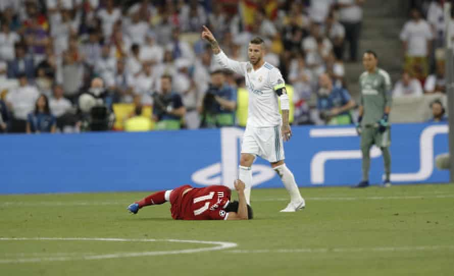 Salah lies injured after fighting Sergio Ramos during the 2018 Champions League final.