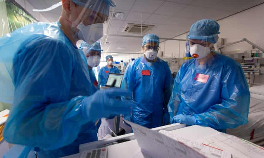 Doctors carry out a ward round in the Covid intensive care unit at the Western General Hospital in Edinburgh.