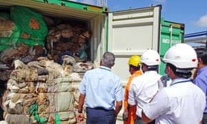 Sri Lankan customs officials inspect the containers at a port in Colombo.