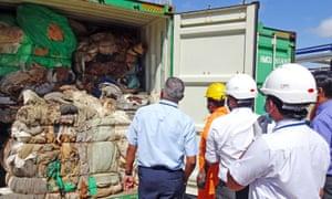 Sri Lankan customs customs officials inspect a container full of mattresses