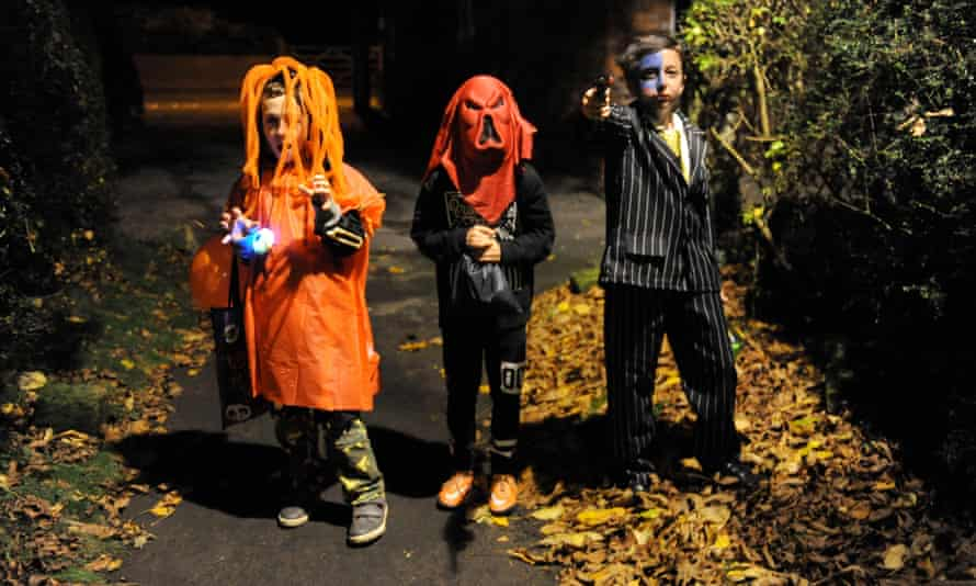 Children go trick or treating in a village in North Yorkshire, UK.