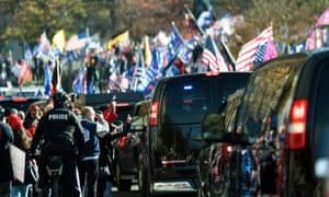 Trump supporters rally as the presidential motorcade departs the White House.