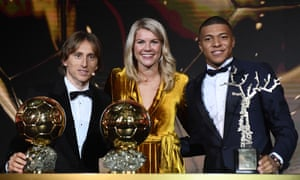 Ada Hegerberg with Luka Modric, winner of the men's Ballon d'Or, and Kylian Mbappé, who won the young player award
