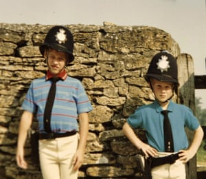 Prince William and Prince Harry dressed as policemen.