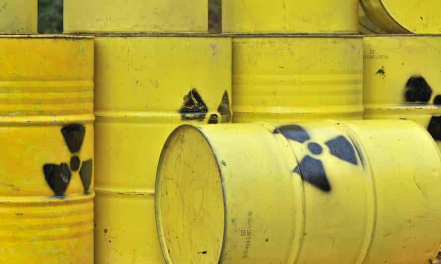 Mock nuclear waste barrels.