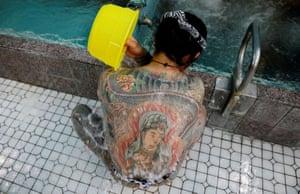 Construction worker Hiraku Sasaki washes at a public bath.