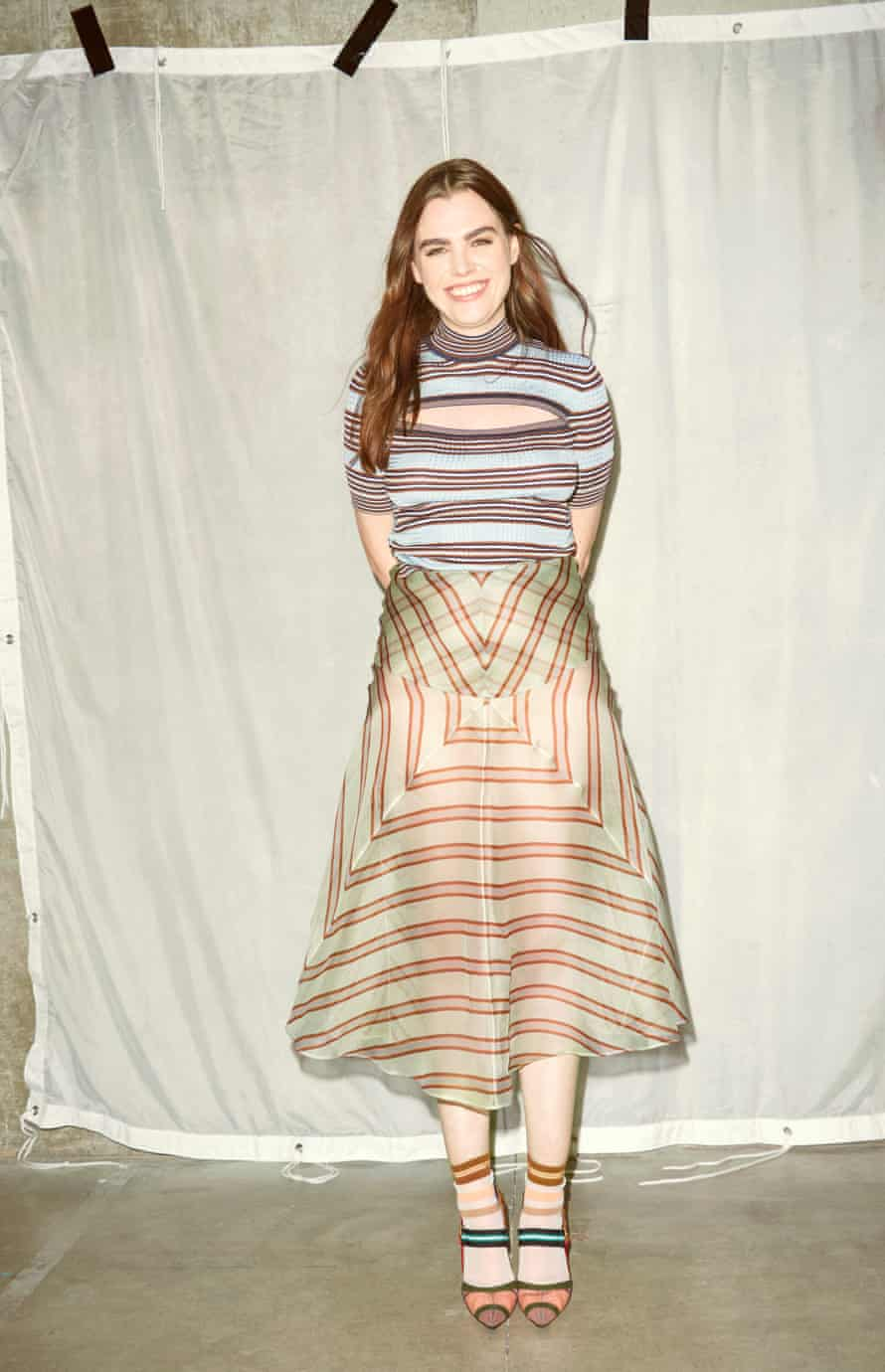 Charli wears top, skirt, socks and shoes all by Fendi.