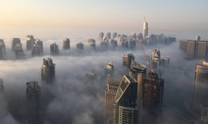 A general view shows the part of the skyline of Dubai covered in an early morning fog on October 5, 2015. AFP PHOTO / RENE SLAMARENE SLAMA/AFP/Getty Images