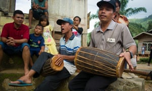 Traditional music performed in a remote village to welcome the travelers.