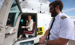 Pilot John McKenzie has a quick chat with Sturgeon before takeoff.