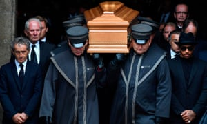 Champion Formula One drivers Alain Prost and Lewis Hamilton flank the coffin of the three-time world champion Niki Lauda as it is carried from the Stephandsdom Cathedral in Vienna, Austria