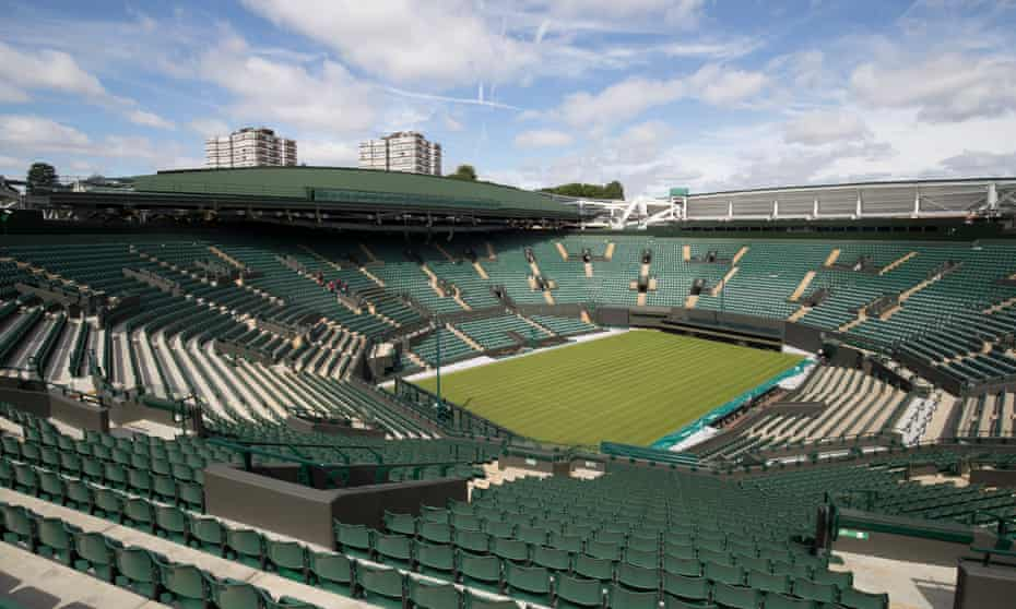 Court One at Wimbledon ready for this year's tournament but showing building work taking place to install a new fully closing roof.
