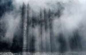 Trees emerge as fog clears up in Lushan Mountains in Jiujiang, China