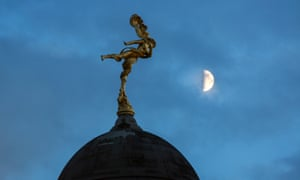 The moon looms over the Bank of England