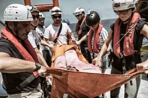 During training, crew practice with stretchers used during rescues