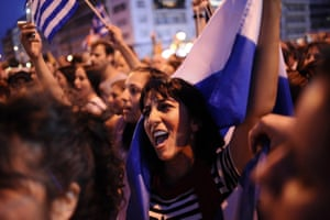 epa04824361 A woman shouts slogans holding a Greek flag during a demonstration of the NO supporters in central Syntagma Square, in front of the Greek parliament building, in Athens, Greece, 29 June 2015. Greek voters will decide in a referendum on next Sunday whether their government should accept an economic reform package put forth by Greece's creditor. Greece has imposed till the referendum capital controls and the banks will be closed till then. EPA/FOTIS PLEGAS G.