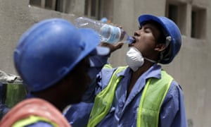 A World Cup worker takes a drink.