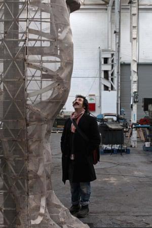 Bull market … Rakowitz inspects his lamassu for Trafalgar Square as it takes shape in the workshop.
