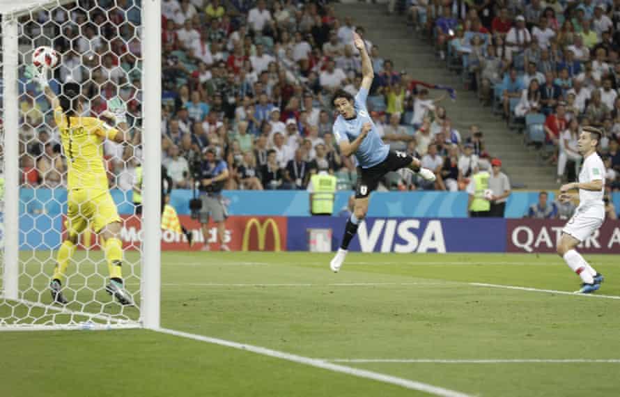 Edinson Cavani scores his side's opening goal against Portugal.