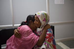 Tahmina*, 13, hugs her mother as they are reunited in the Child Welfare Committee in Haryana