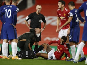 Manchester United's Marcus Rashford receives medical treatment.