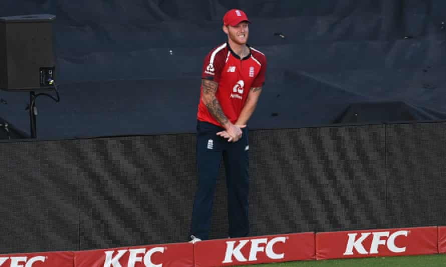 Ben Stokes winces after hurting his hand fielding on the boundary perimeter advertising boards.