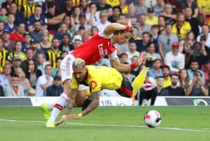 Roberto Pereyra of Watford is fouled by David Luiz of Arsenal, conceding a penalty. The unnecessary lunge by Luiz was one of two calamitous defence moments from Arsenal, who threw away a two-goal lead to draw 2-2.