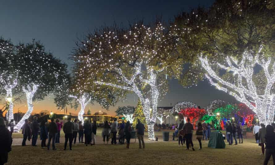 Despite the risk of coronavirus, people flock to the small Christmas village of Fredericksburg, Texas.