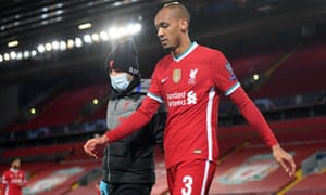 Fabinho leaves the game after picking up an injury during Liverpool's win against Midtjylland at Anfield.