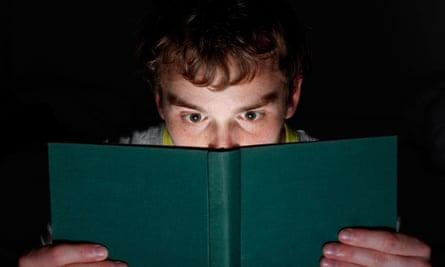 A man reading at night