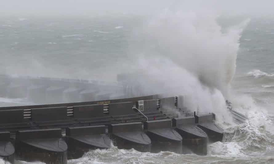 Waves crash over the marina wall in Brighton during Storm Doris