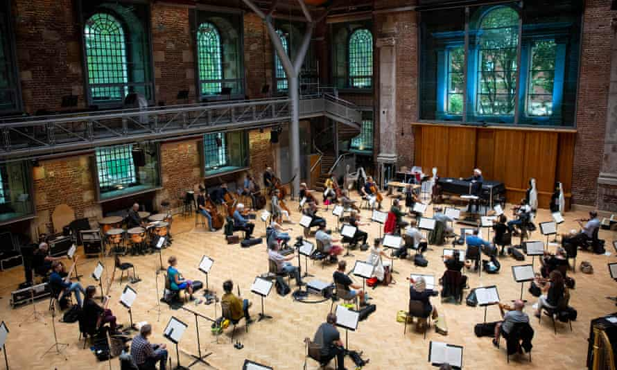 Simon Rattle rehearses with the London Symphony Orchestra