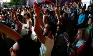 Iranians celebrate in the streets of Tehran