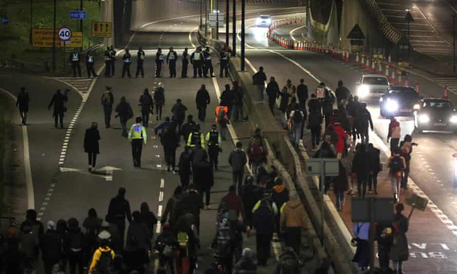 Protesters walk along the A4032 which leads to the M32 in Bristol