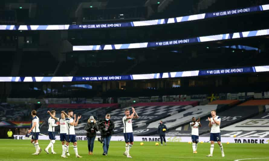 Spurs players applaud fans scattered in the vast Tottenham Hotspur Stadium after their 2-0 victory over Arsenal in the north London derby.