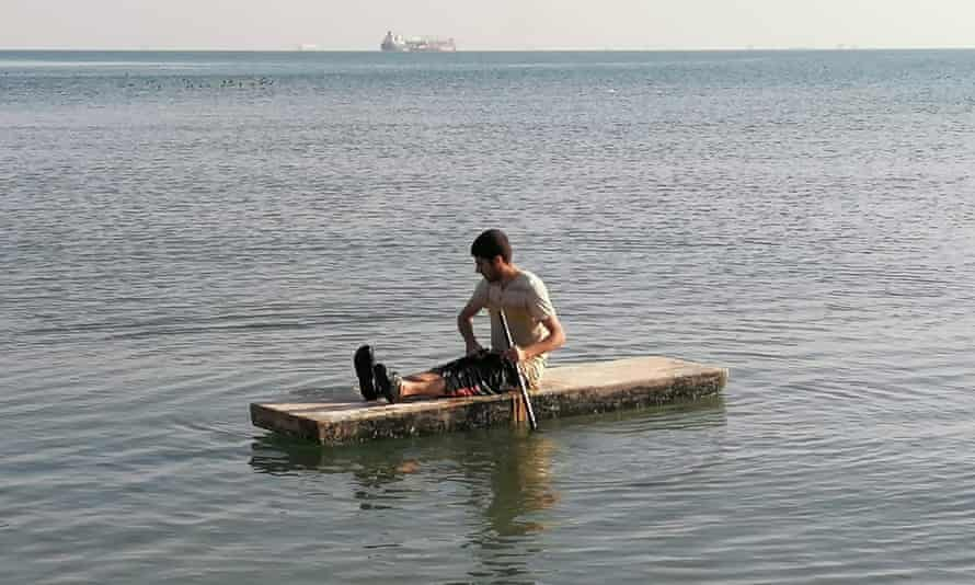 Mohammad Aisha rows to shore from the MV Aman ship, which he has lived on for two years.
