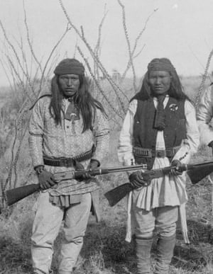 Two Native Americans carrying Winchester rifles, 1885.