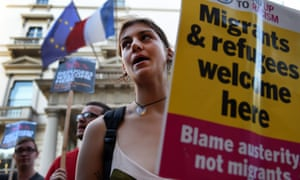 Protesters demonstrate outside the French embassy in London calling for UK to welcome refugees.