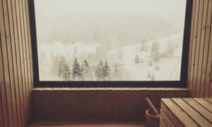 A snowy scene viewed from the sauna at Akasha Wellness Retreat, Romania