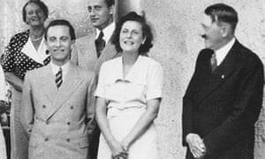 Leni Riefenstahl, standing with Hitler in 1938.