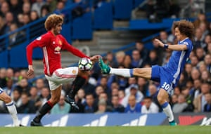 Luiz fouls Fellaini and is shown a yellow.