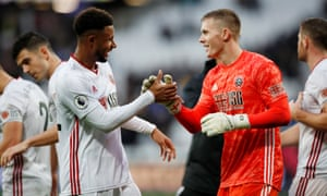 Sheffield United's Lys Mousset celebrates with keeper Dean Henderson.