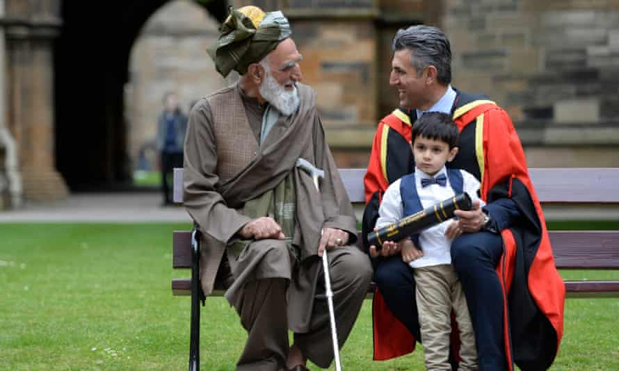 Sabir Zazai with his father, Mohammad Zahir Zazai, and his three-year-old son, Adam, after receiving his honorary doctorate from the University of Glasgow.