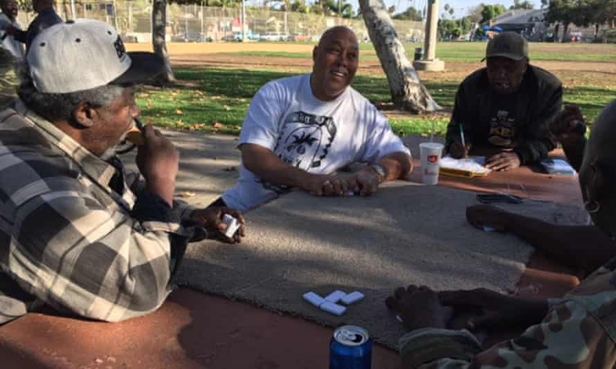 Donald Coulter, centre, playing dominos with friends in Oakwood park, Venice